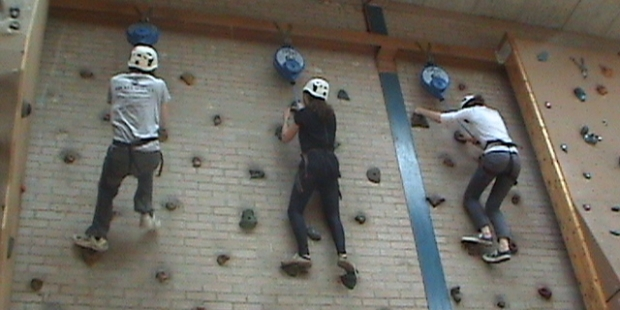 NYRO course members relaxing on the climbing wall at Howells' School!